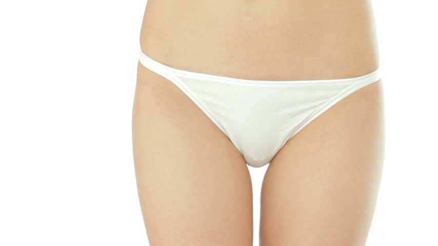 calcinhas : Young woman in white panties isolated on white background Vídeos