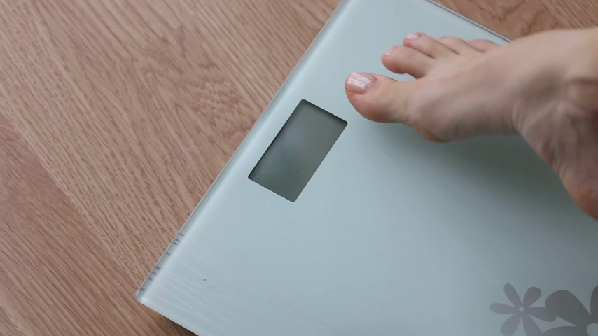 paunchy : Obese woman getting on scales for weight control during healthy diet, weightloss