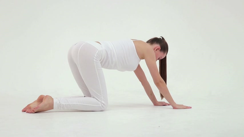 pilates : Girl doing exercive with mace in the hand in the studio on white background, slow motion