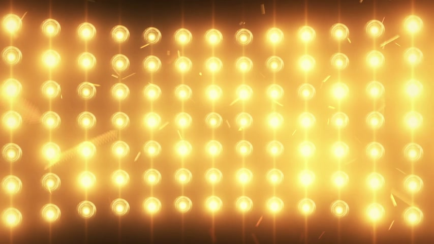 zeď : Bright flood lights background with particles and glow. Seamless loop.