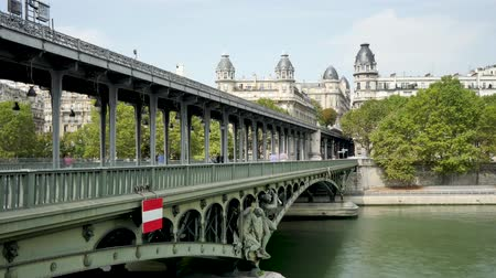 french metro : Time lapse of the Bir-Hakeim bridge where the people pass or over the river of Paris, the Seine.