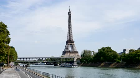 bir hakeim bridge : In Paris, during the summer. The Seine quays next to the Seine (paris river) are almost empty. In front of the Eiffel Tower, the famous Bir-hakeim bridge, where the metro passes.