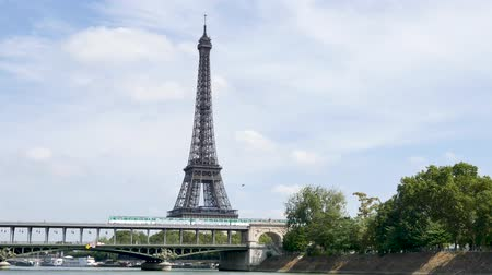 bir hakeim bridge : In Paris, during the summer.In front of the Eiffel Tower, the famous Bir-hakeim bridge, where a metro is passing.