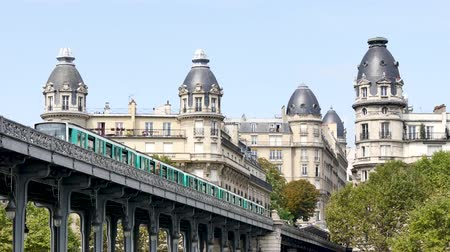 bir hakeim : In Paris, the bir-hakeim bridge crosses the Seine, near the Eiffel Tower. Close-ups of the buildings between which the subway arrives. Metros leave and arrive at Passy station, in the 16th arrondissement.