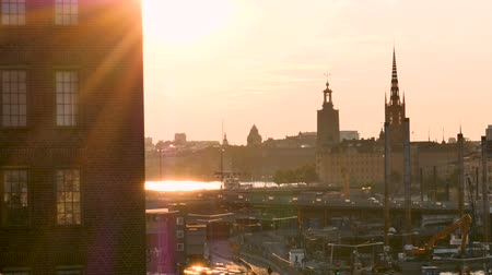 stockholm : Stockholms cityscape, backlight. In the foreground, we can see that the city is growing. In the background, historic buildings. Filmed during the summer. Stock Footage
