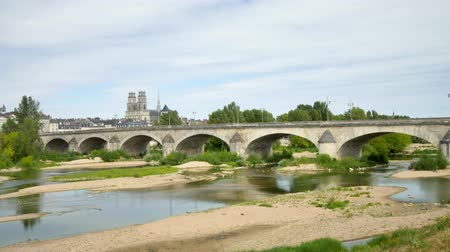 Time lapse in the city of Orleans, during the summer. View on the most famous bridge of the city and its cathedral.