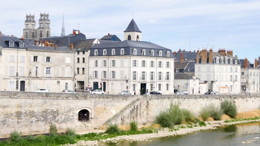 Bank of the Loire, Orleans, city of France, during the summer. We can see the cathedral, and historic buildings. Horizontal panorama.