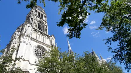 In the city of Orleans, there is a cathedral called Holy Cross in frencg. Closed view of the cathedrals towers.