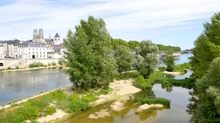 Orleans is a prefecture and commune in north-central France. Landscape of the river. In the background, there is the famous cathedral.
