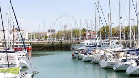 new town : In the city center of La Rochelle, a town in the west of France, located in the department of Charente-Maritime. Theres a wheel behind the old port.