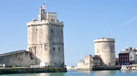 Западная Европа : The famous towers of the old port of La Rochelle, a town in western France, located in the Charente-Maritime department.