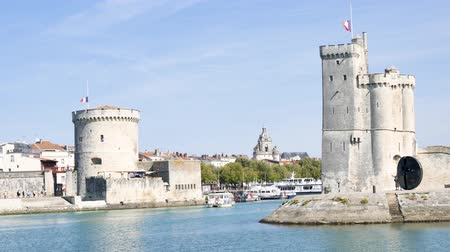 Западная Европа : The famous towers of La Rochelle, a town in western France, are located at the entrance to the old port. La Rochelle is the capital of the Charente-Maritime department.
