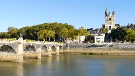 The Verdun bridge in Angers (France) is a bridge with masonry vaults. It is the oldest passage of one side of the Maine river to the other. In the background, there is the Cathedral of Angers. Стоковые видеозаписи