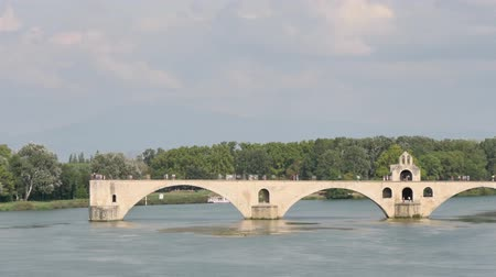 Time lapse of Rhone river in Avignon, southern France. On the river, there is a famous medieval bridge called Pont dAvignon or Pont Saint-B?n?zet in french (Avignon bridge in english).