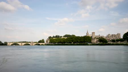 mediaeval : Time lapse in Avignon, city of southern France. The bridge and the Papal palace, next to the bridge, are both famous medieval monuments in this old city. The river is the Rhone.