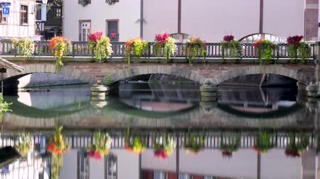 "Time lapse of a flowered bridge in the old part of Strasbourg, the ""Petite France"" district (""little France"" in English). The city is located in Alsace, eastern France. Filmed in october 2018. Стоковые видеозаписи"