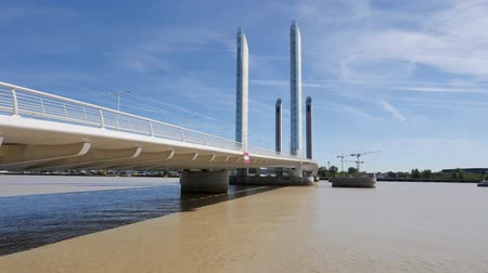 Time Lapse of The Jacques Chaban-Delmas Bridge. It is a vertical-lift bridge over the Garonne in Bordeaux, France. Filmed in October 2018 during a sunny day.