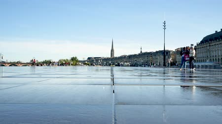 Time lapse. The Mirror of Water (Water Mirror) or Mirror of the Quays (Quay Mirror) in Bordeaux is the worlds largest reflecting pool, located on the Quay of the Garonne in front of the Place de la Bourse.