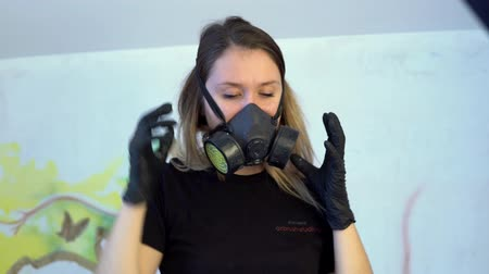 respirator : the girl wears a respirator and smiling