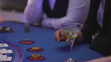 patins : Gambling blackjack in a casino - nervous gambler playing with chips