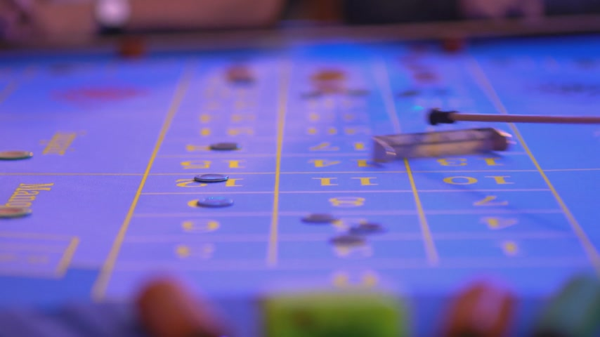 patins : Roulette table in a casino - croupier Removes lost tokens from table