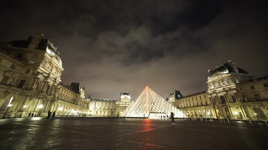 french metro : Wide angle shot of the Louvre museum by night - PARIS, FRANCE Stock Footage