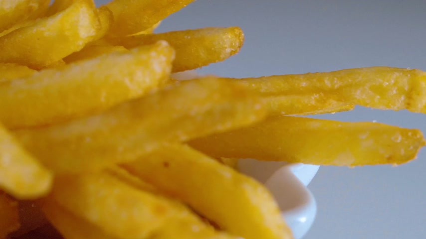 fry : Golden fried sticks of delicious French Fries Stock Footage