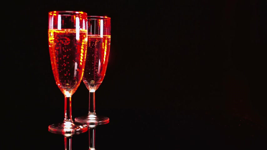 beautifully : Glasses of Champagne - beautifully illuminated Stock Footage