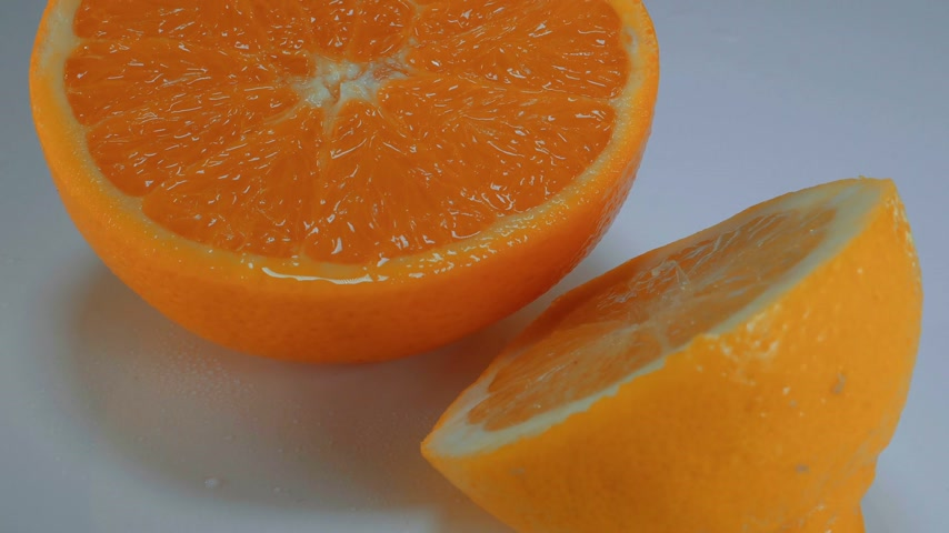 овощи : Fresh sliced orange - close up shot Стоковые видеозаписи