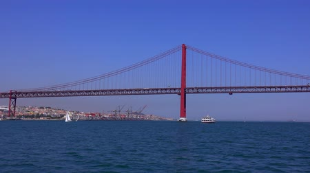 augusta : 25th April Bridge over Tagus River in Lisbon aka Salazar Bridge Stock Footage