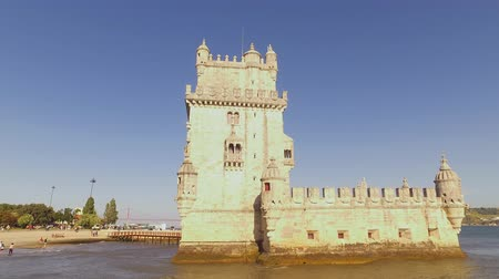 street prhotography : Famous landmark in Lisbon - The Belem Tower - LISBON  PORTUGAL - JUNE 14, 2017