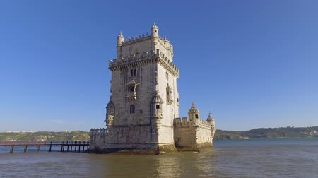 street prhotography : Famous Belem Tower in the city of Lisbon - LISBON  PORTUGAL - JUNE 14, 2017 Stock Footage