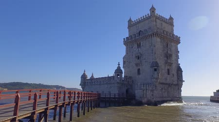 street prhotography : Important tourist attraction in Lisbon - The Tower of Belem - LISBON  PORTUGAL - JUNE 14, 2017