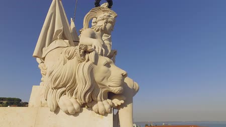 street prhotography : The beautiful statues on the top of Augusta Street Arch in Lisbon