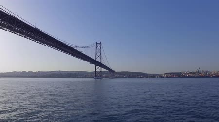 street prhotography : Imoressive Bridge over Tagus River in Lisbon - The 25th April Bridge aka Salazar Bridge
