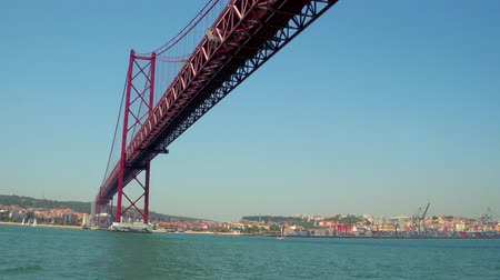 street prhotography : Famous 25th April Bridge over River Tagus in Lisbon aka Salazar Bridge