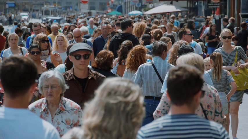 all ages : Big Crowd of all ages walking through a city - Extreme Slow Motion - AMSTERDAM  HOLLAND - JULY 21, 2017 Stock Footage