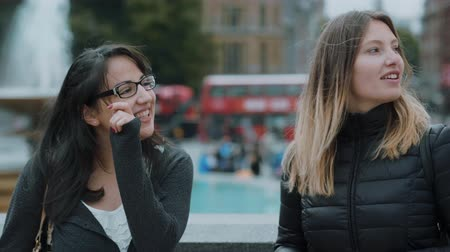 multirracial : Two girlfriends on a sightseeing trip to London