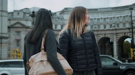 multirracial : Two young women on a sightseeing tour through London
