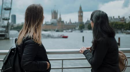 multirracial : Two girls in London - having fun on a sightseeing trip