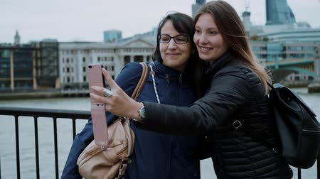 multirracial : Taking photos at the banks of River Thames in London