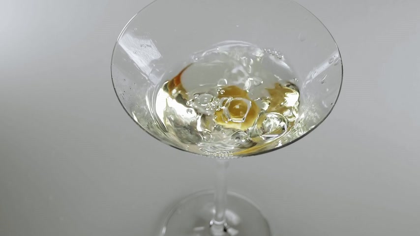 martini glasses : Close up shot of martini cocktail with olive - a classic drink