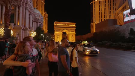 blackjack : Tourists in als Vegas walking along the strip at Paris Hotel - USA 2017 Stock Footage