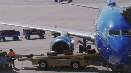 landing field : Loading baggages into airplane at the gate - USA 2017