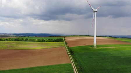 uzak : Aerial flight over wind power plants - wind energy mills from above Stok Video