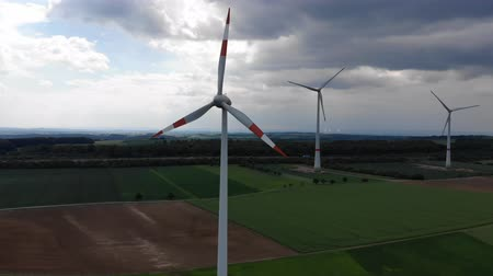 ротор : Aerial flight over wind power plants - wind energy mills from above Стоковые видеозаписи