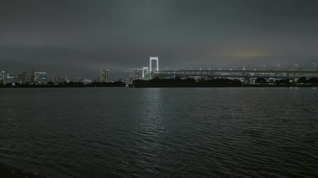 junho : Rainbow Bridge and Skyline of Tokyo by night - beautiful view from Odaiba - TOKYO  JAPAN - JUNE 12, 2018