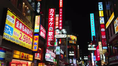 tradição : Neon advertising and city lights in Shibuya - a crowded area at night - TOKYO  JAPAN - JUNE 12, 2018