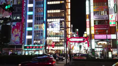 shinto : Popular nightlife in Tokyo - the busy area of Shinjuku - TOKYO  JAPAN - JUNE 17, 2018 Stock Footage