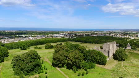 lakes of scotland : Flight over Craigmillar Castle and the city of Edinburgh Stock Footage